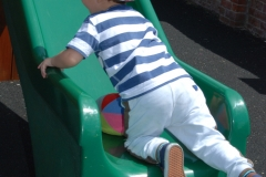 child going up slide