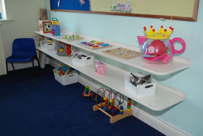 hc baby toys on shelf close up