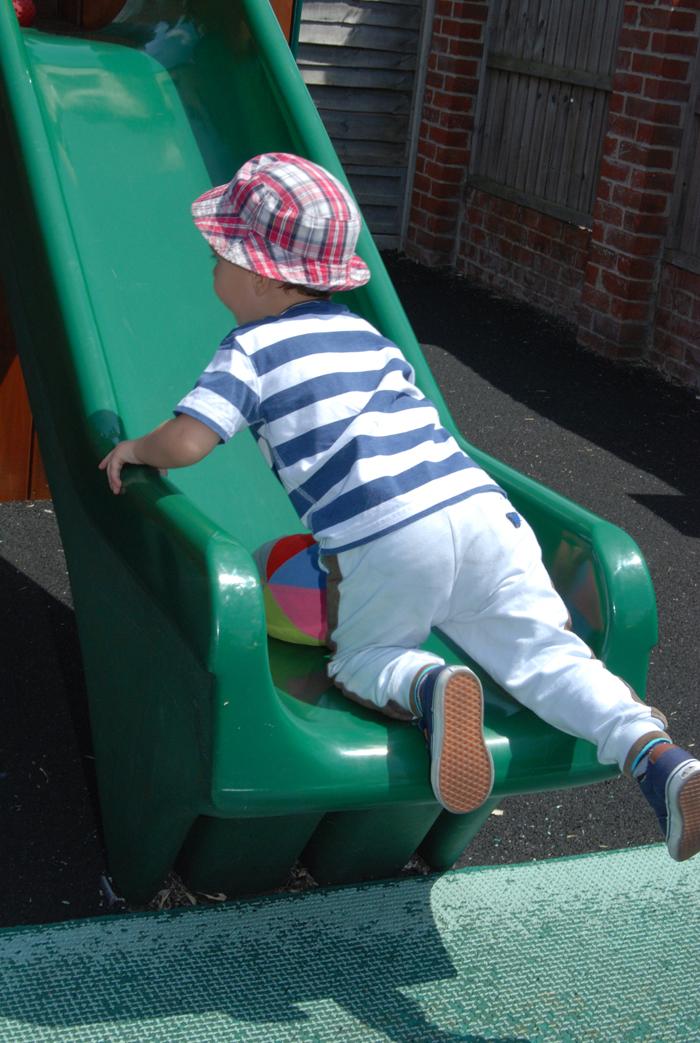 child going up slide