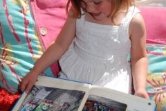 child reading outdoor portrait